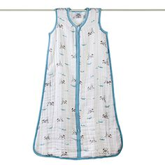 Sleep sack. Easy and breathable. The zipper gets a lot of use so look for one with good quality.