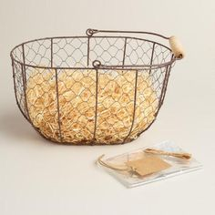 Oval Rustic Wire Basket Kit | World Market - this might be a cute fruit basket to match my country kitchen feel...