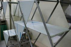 Reorganized Bookshelf is a minimalist design created by Germany-based designer Phillipp Beisheim. The shelf represents a rearranged icosahedron. (3)