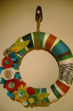 Wool and felt flower wreath - has possibilities for a Christmas wreath?