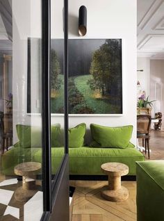 Greenery - Pantone color of 2017 in interior design. Greenery sofa together with wooden elements looks very fresh and natural.