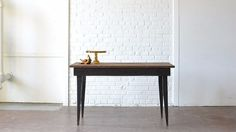 Vintage wooden farm table with gorgeous contemporary style legs painted black. Wonderful cake table and perfect for stylized photo shoots.