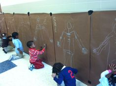 """Life-Size Chalk Drawing of """"My Skeleton"""" (final step is labeling bones, spine, skull, etc.) in preschool and Pre-K (hospital or Halloween theme)"""