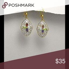 Gem Stones and White Diamond Earrings 14k Yellow Gold and Rhodium plated Brass Earrings decorated with Garnet, Amethyst, Sky Blue Topaz, Peridot and White Dimond. Width 14 mm. Height 37 mm. Jewelry Earrings