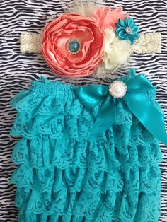 Hey, I found this really awesome Etsy listing at https://www.etsy.com/listing/188738460/vintage-teal-and-coral-romperfirst