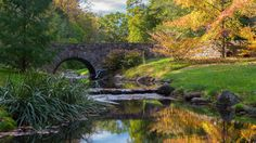 Storybook Creek - Scenic view of autumn reflections and water under a bridge, located in Delaware.