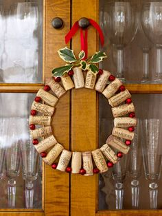 Pop Out the Cork:Add pop to a dining room with wine corks wired to tiny red jingle bells. Take about 22 corks of the same size and 22 small (3/8 of an inch) red bells bought from a crafts store. Drill a small hole (just big enough to fit your wire through) 1/4 of an inch from the top of each cork and another 1/4 of an inch from the bottom. It is very important to make sure all the drilled holes at the top line up with the holes at the bottom.