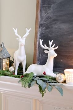 A traditional Christmas mantel with greenery, white, a simple chalkboard and galvanized metal wreath | Finding Home Farms