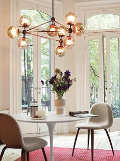 Saarinen Round Dining Table | Designed by Eero Saarinen light fixture  Sunday morning brunch, coffee, OJ, croissants, the sunday newspaper and your favourite person sat next to you.....here, in this picture, in this room