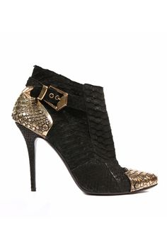 I love the gold metallic reptile effect on these booties from Balmain spring 2012 collection...  Walkability Rating: 8/10