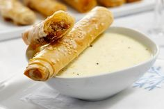 Pastry Rolls Filled with Sausage Served with Orange Dip