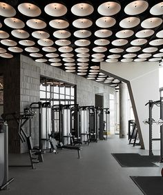 The gym is located in Dubai Design District home to the region's most growing and vibrant design community. The client's program included a gym floor, juice bar, cycling studio and circuit training factory all in a limited space of 600 sq m. Dubai, Fight Club, Warehouse Gym, Warehouse Design, Gym Club, Gym Interior, Interior Design, Gym Lockers, Gym Room