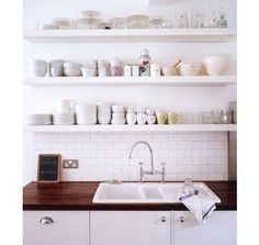 wood countertop, subway tile backsplash to open shelving -- needs some color for interest, but this idea is lovely