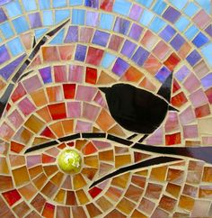 Black bird against colorful mosaic background. Love the contrast.