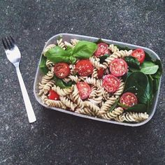 Lunch was brown rice fusilli with basil walnut pesto, baby spinach and cherry tomatoes #Padgram