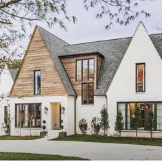 So pretty @domainedevelopment, loving that wood detail! White+ wood exterior