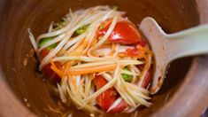 This dish is one of the most popular dishes in Thailand. Spicy Papaya Salad easily made and tastes amazing - it has all the flavors; Sweetness from the palm sugar, Sourness and bitterness from the lime, and Saltiness from the fish sauce. Try it!
