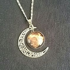 NEW Moon Necklace NEW Moon Necklace...super cute silver necklace with silver half moon and hanging moon accent Boutique Jewelry Necklaces