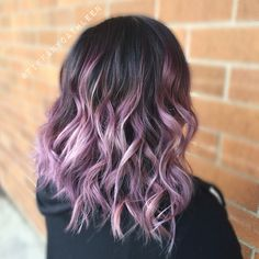 Smoky lavender balayage ombré on a wavy long bob.