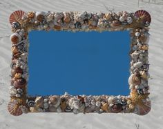 You can make one of your own shell mirrors or picture frames. Just collect shells and hot glue them on!!