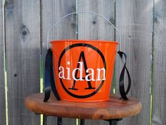 Orange Halloween Bucket Personalized - 5 Quart. $22.00, via Etsy.