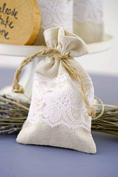 4.99 SALE PRICE! The perfect wedding favor bags. Our best selling favor bag. Soft linen blend with lace. This is for a 12 pack. Each bag has a jute drawstrin...