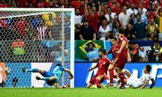 Eduardo Vargas scores Chile's opening goal in the first half past Spain's goalkeeper, Iker Casillas.