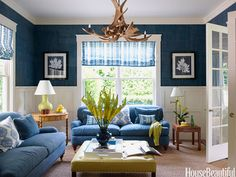 The sofa is upholstered in Hinson's Rawlston in Dunham Blue. Design: Meg Braff. #blue #sofa