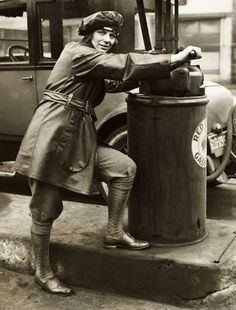 A female gas station attendant, 1927, Chicago.