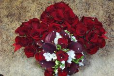 Red rose bridesmaids bouquets and red and white bridal bouquet