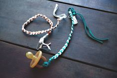 i saw these awesome pacifier clips online but sadly they have been sold out. so i gathered my crafty self, found 15 mins in my day (i made a few) and got to braiding. they were simple and easy to d...