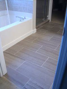 Walls and bathroom floors are 12 x 24 Grey Marble from Floor and Decor Outlets.  The Marble was $5.29/sq ft!