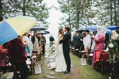 rainy day wedding... I feel like umbrellas are not a bad look.  the show must go on.