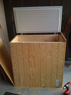 wood paneling to hide a chest freezer  ...  I wonder if we could use the leftover vinyl flooring!  LOL!