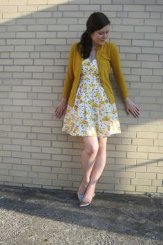 yellow dress and cardigan, silver shoes
