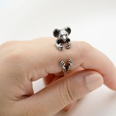 This ring is made in the shape of a koala that wraps around your finger. They are one size fits all and are plated in silver, bronze and black. This is perfect for anyone looking for unique cute anima