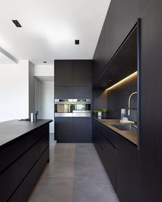 "Scandinavian Colour + Design on Instagram: ""The COOK'S KITCHEN // Matte black finishes, concealed appliances, polished concrete and storage, storage, storage :) Team DS. X #designstuff #minimaliststyle #kitcheninspo #kitchenideas #blackkitchen #polishedconcrete #architectdesigned #dkoarchitecture #melbourne #australianinteriors #australianinteriordesign"""