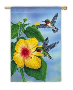 """Hummingbird Duo Flag (Garden Size) by House-Impressions. $5.99. A flag is the greeting card of your home; Silk Reflections Flag; 12.5"""" x 18""""; Multi-colored; Great for yourself or as a gift. Like a ballet frozen in time, these stunning hummingbirds dance on the breeze. Surrounded by the vibrant blooms of the garden and the deep blue sky beyond, they are eye-catching. This is a flag that celebrates the simple glories of the season with every movement in the wind."""