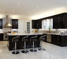 I'd want different colored cabinets and granite but I would love a kitchen like this.