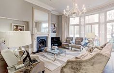Elegant traditional style living room decor with curved sofa in antique velvet & crystal chandelier Living Room Decor Traditional, Curved Sofa, Space Furniture, Slipcovers, Your Space, Living Area, Shoe Rack, Chandelier, Design Ideas