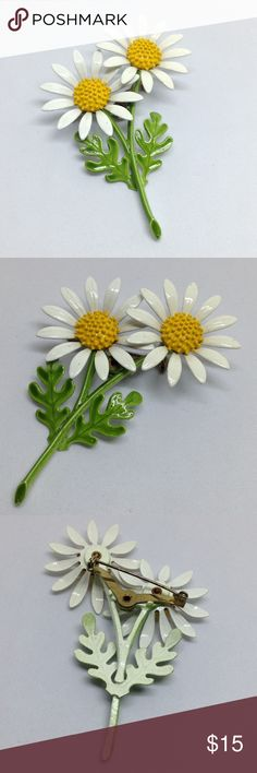 """Vintage Enamel Double Daisy Pin A 3 1/4"""" x 2 1/4"""" Vintage Daisy pin with two daisies in white and yellow enamel, with a green stem. In excellent vintage condition for its age!! Flower pins have become very popular and difficult to get with the advent of the """"Pin Bouquet"""". This beauty could be part of your own bouquet someday! Vintage Jewelry Brooches"""