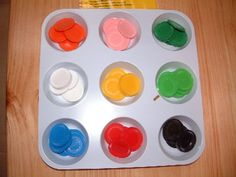 Sort & count colored buttons Purpose Differentiate between colors Buy/DIY materials DIY (tray with slots, color buttons)