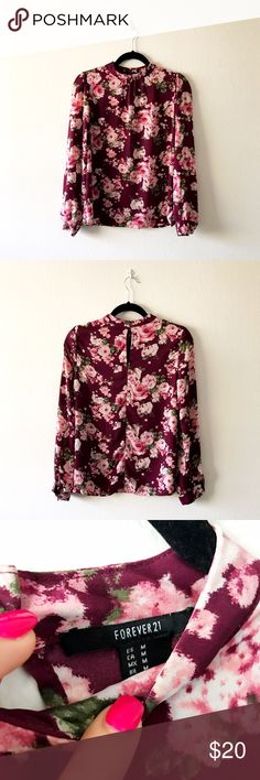 Gently used burgundy floral Mock neck blouse Excellent used condition, this gorgeous shirt has a Mock neck with button/loop closures. Lightweight, drapey material. Long sleeves with button placket closures. Tops