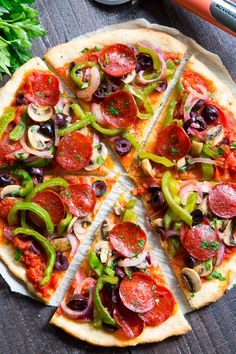 This paleo pepperoni pizza is loaded with all your favorite veggies and packed with flavor! It& baked on the perfect paleo pizza crust and is totally dairy free, gluten free, grain free and soy free This healthy pizza is family approved and eas Paleo Pizza Crust, Healthy Pizza, Healthy Appetizers, Paleo Recipes, Whole Food Recipes, Paleo Food, Paleo Meals, Paleo Running Momma, Dairy Free Pizza