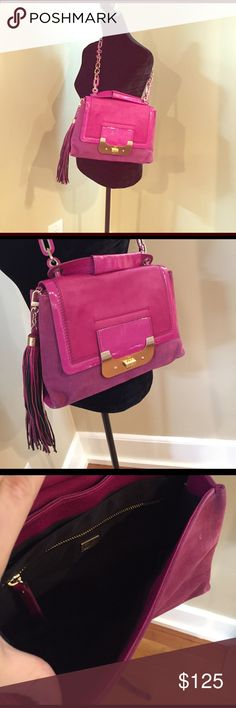 DVF Harper bag in fushia Multi functional handbag that can be worn as a cross body or used as a clutch.  It is a gorgeous fuchsia color with fuchsia interwoven into the gold chain link cross body handle. Diane von Furstenberg Bags