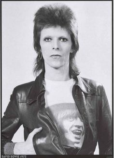 A great portrait poster of an Aladdin Sane-era David Bowie in 1973! Oh, Honey - Watch that man! Ships fast. 24x33 inches. Check out the rest of our amazing selection of David Bowie posters! Need Poste