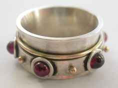 Handmade Sterling Silver 18ct Gold Garnet Spinner by CitrineSunset, $400.00 Spinner Rings, African Jewelry, Bangles, Bracelets, Handmade Sterling Silver, Garnet, Trending Outfits, Unique Jewelry, Handmade Gifts