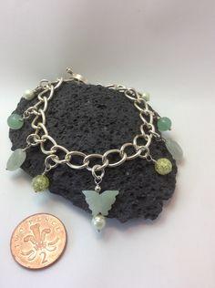 A personal favourite from my Etsy shop https://www.etsy.com/uk/listing/465105477/aventurine-gemstone-charm-bracelet