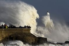 Huge waves strike the harbour wall and lighthouse at Porthcawl, south Wales.