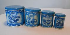 Vintage Wolverine USA Tin Litho Delft Blue Nesting Toy Doll 4 Piece Canister Set, SOLD 1/5/15   $52.01